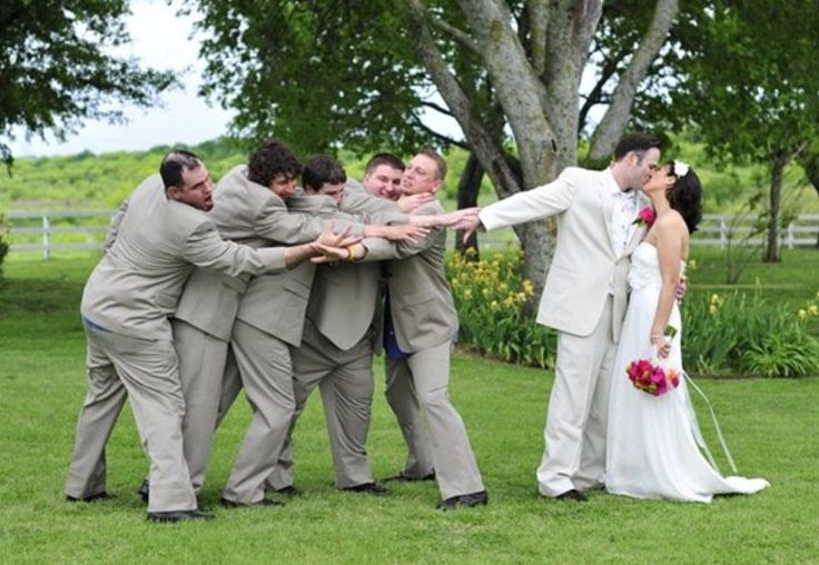 Haha with the best man holding the others back. That's awesome.