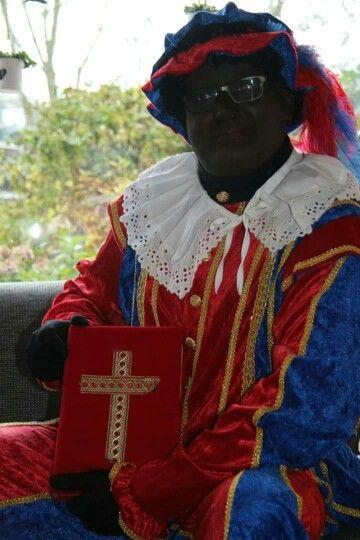 Piet Franco met het grote boek van Sinterklaas
