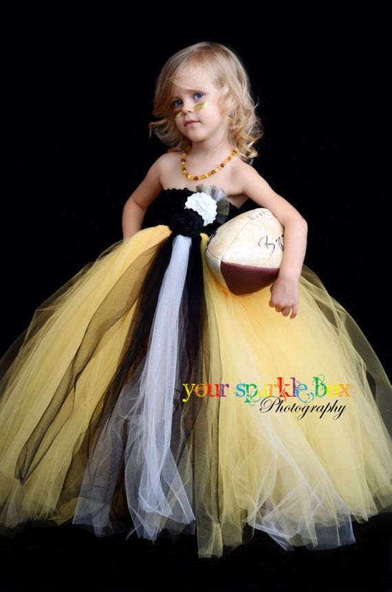 Football tutu dress...except for a cowboys one so she doesn't have to be embarrassed ;)