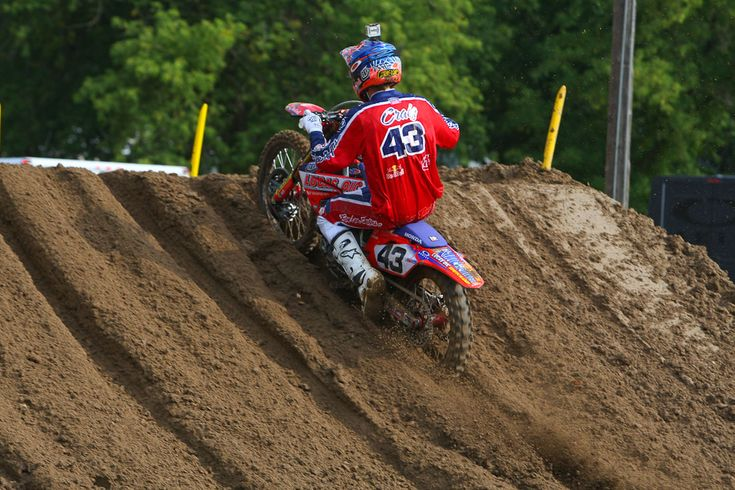 Spring Creek 2012: Seely- Transworld Motocross. Deep ruts on a jump face, fully compressed rear suspension