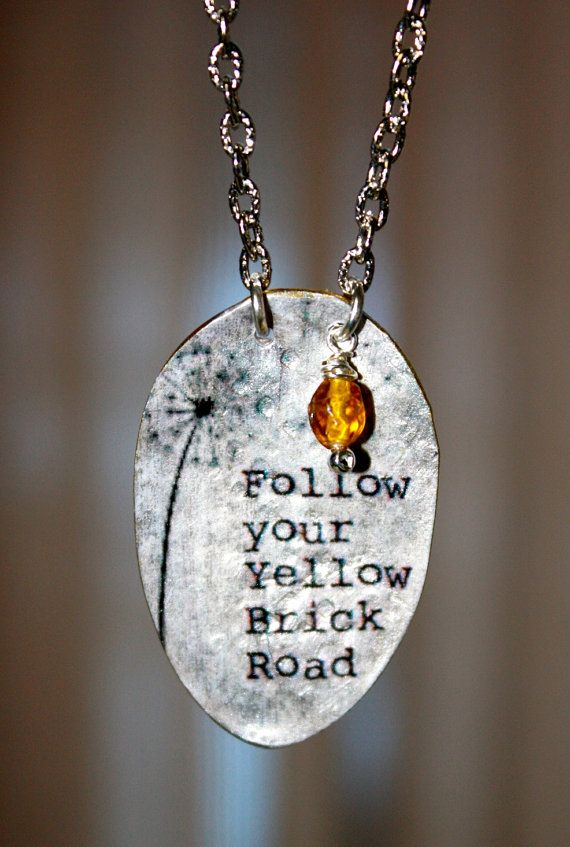 Follow Your Yellow Brick Road  Created from a vintage silverplate teaspoon, this unique pendant has an image of a dandelion along with the Wizard