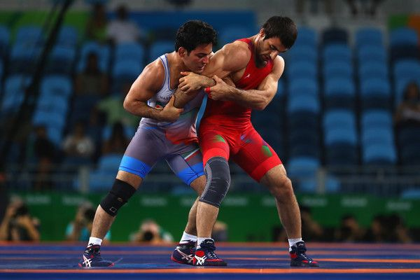 Habibollah Jomeh Akhlaghi Photos Photos - Saman Ahmed Tahmasebi of Azerbaijan and Habibollah Jomeh Akhlaghi of the Islamic Republic of Iran compete during the Men's Greco-Roman 85 kg Repechage on Day 10 of the Rio 2016 Olympic Games at Carioca Arena 2 on August 15, 2016 in Rio de Janeiro, Brazil. - Wrestling - Olympics: Day 10