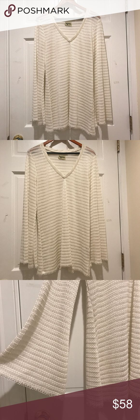 Show Me Your MuMu Cream Bell Sleeve Crochet Tunic Gorgeous slinky cream Tunic in open knot Crochet, bell sleeves and slouchy V neck! Perfect beach wear, cover up or paired with a crop top and cutoffs.  Excellent condition, worn once to a festival- one flaw - small round burn mark on sleeve near cuff - not very noticeable due to the location and the texture of the top. Show Me Your MuMu Tops Tunics