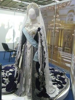 Empress Maria Feodorovna of Russia and the traditional court dress she's wearing in her 1912 portrait by Vladimir Makovski.