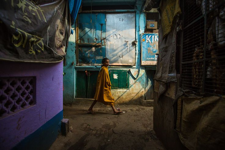 Untitled - Young Indian girl walks down a narrow street in Kolkata, West Bengal…