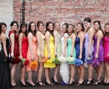 I kinda like the idea of the different color dresses - you would just need a BIG wedding party!