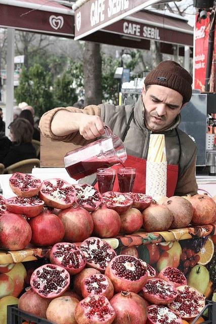 Istanbul market, fresh juice, pomegranate.