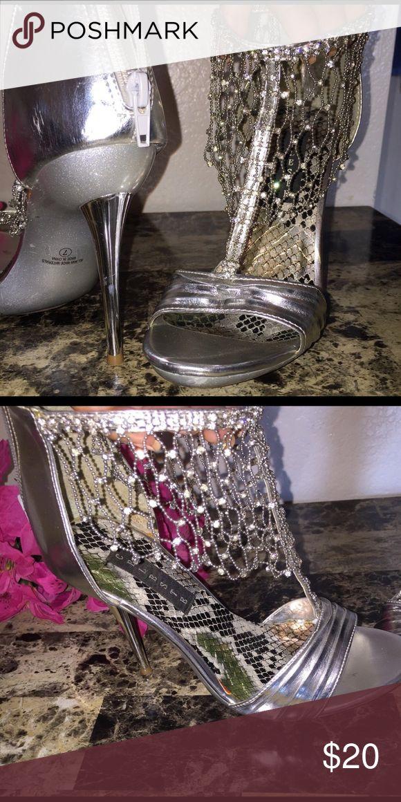 gray open toe t-strap stilettos Women's pair of silver open toe t-strap stilettos size 7 wore once for my wedding Shoes Heels