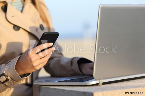 Self employed woman working with a laptop and phone