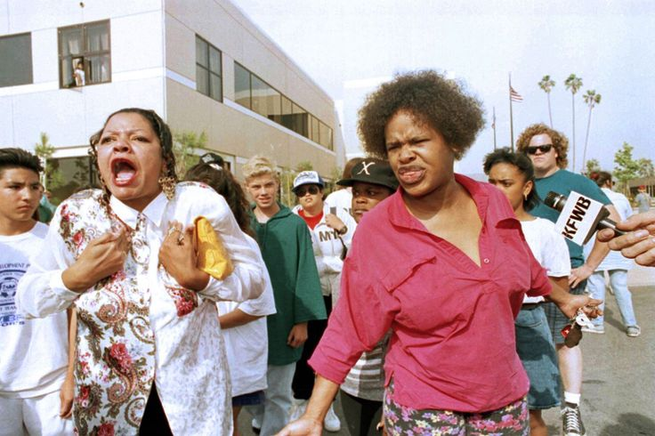 A pair of unidentified women angrily express their displeasure after the verdicts acquitting four LAPD officers of all charges but one in the Rodney King assault case were announced at a Simi Valley courthouse Wednesday afternoon, April 29, 1992. (Photo: Bob Galbraith/AP)