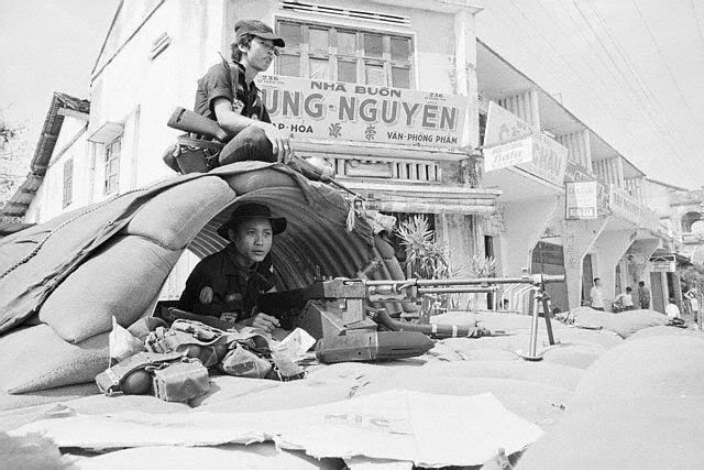 South Vietnamese soldiers man their weapons in a sandbag bunker built in the middle of the street in Kontum city