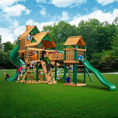 Gorilla Playsets Treasure Trove Wood Swing Set. 1st Level platform 5' x 5' x 5'. 2nd level platform 2.5' x 5' x 7' with wood roofs with sunbursts, dormers, and a chimney, Tower with heavy duty vinyl cover. 3 swing beam positions, 2 belt swings, bonus glider swing. Trapeze Swing, extreme wave slide, radical ride tube slide, deluxe climbing rope ladder, safe entry ladder. Sand box with mesh sandbox cover, bonus sandbox under tower, large picnic table, and rock wall with climbing rope…