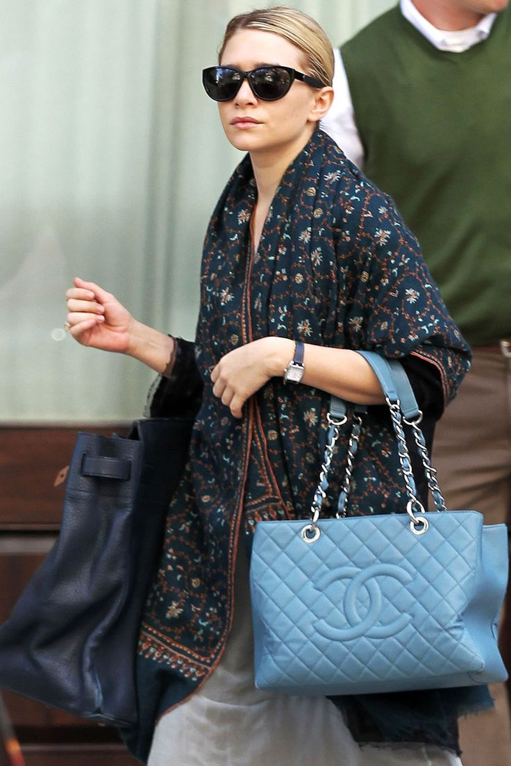 One big bag is okay. Two, and you'll look like a bag lady. Just try to keep Ashley Olsen away from her torso-sized Birkin and her jumbo Chanel.