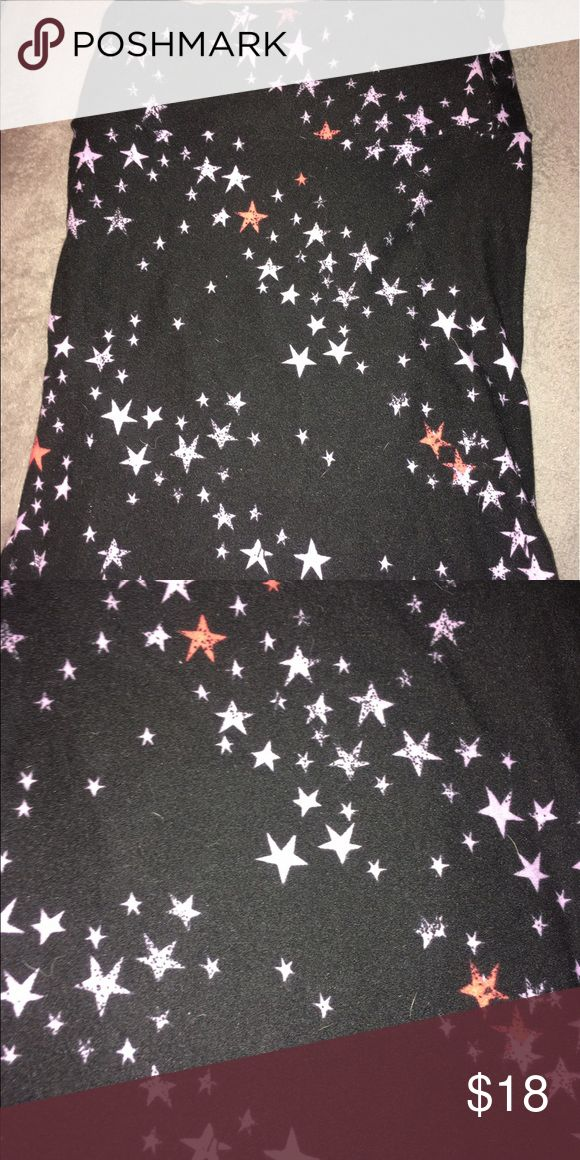 LuLaRoe Star TC Leggings Worn twice, washed twice. There is a Little wear on the butt area. Black background with light purple and coral stars. Made in Indonesia. We are a smoking and pet household so you are aware. LuLaRoe Pants Leggings