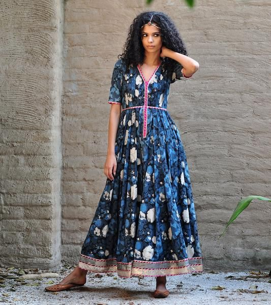 Our breezy cotton gown is crafted in pure cotton fabric, with an overall floral pattern that is block printed using all natural dyes. This gorgeous piece featur