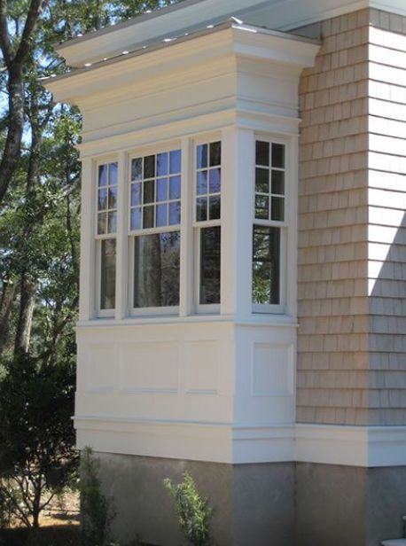This is not at all the exact look, I need to get you a photo of what we did to an addition at 6 Bridge Lane.  What about the corner sections of the house being done in a very classic (not traditional like this) Hardie panel detail vs stucco?