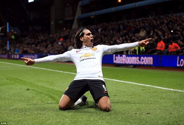 Falcao slides on his knees in front of the travelling United supporters as he celebrates his strike