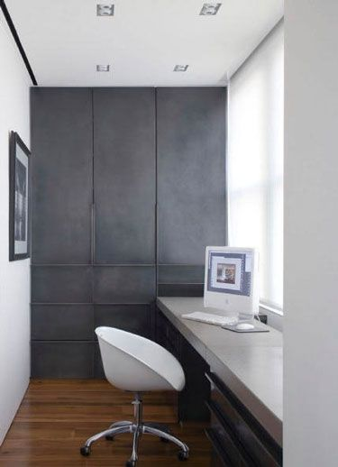 love the wall of cabinets. and the desk. love the materials. blackened steel and concrete? photo: Peter Margonelli
