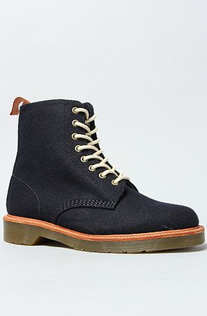 The Beckett 8-Tie Boot in Navy by Dr. Martens  get 20% off with use of repcode: PLNDR11