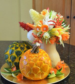 All vegetable and pumpkin carving centerpiece. See detailed photos at http://www.vegetablefruitcarving.com/blog/nitas-thanksgiving-centerpiece/