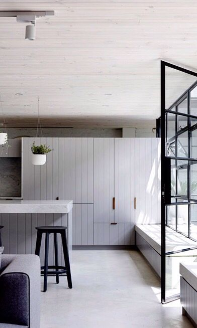 Wood panelled kitchen cabinetry and framed glass - Architects EAT /
