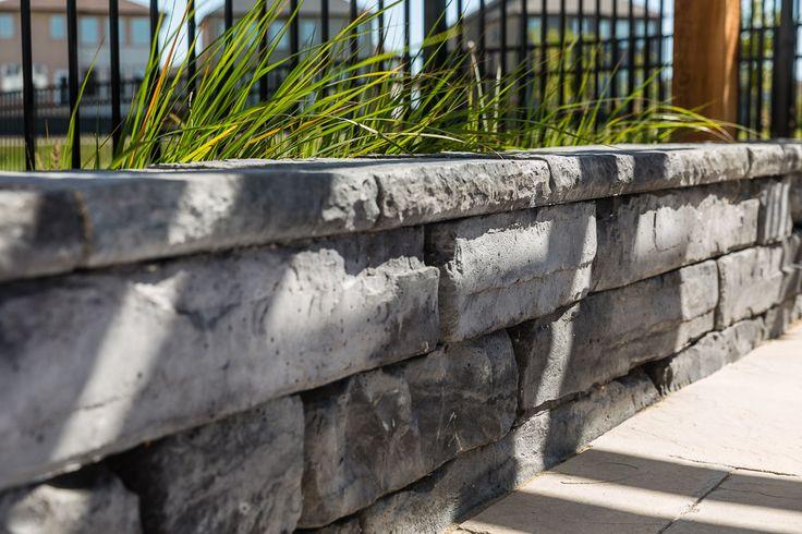 Rosetta Kodah retaining wall. We really like the linear, chiseled stone look.