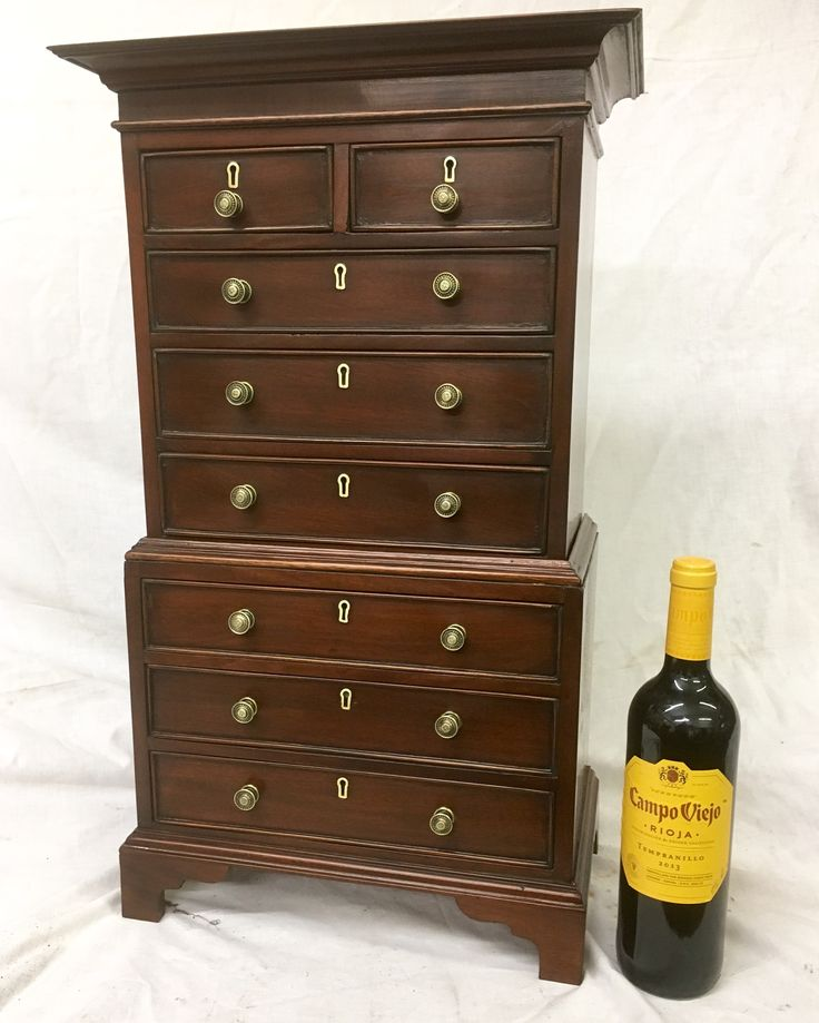 Miniature mahogany George lll style tallboy, only 24 inches high and 12 inches wide . Often associated with apprentice furniture .