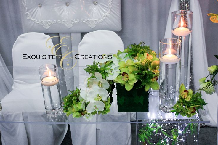 Green centerpiece and cylinder floating candle vases