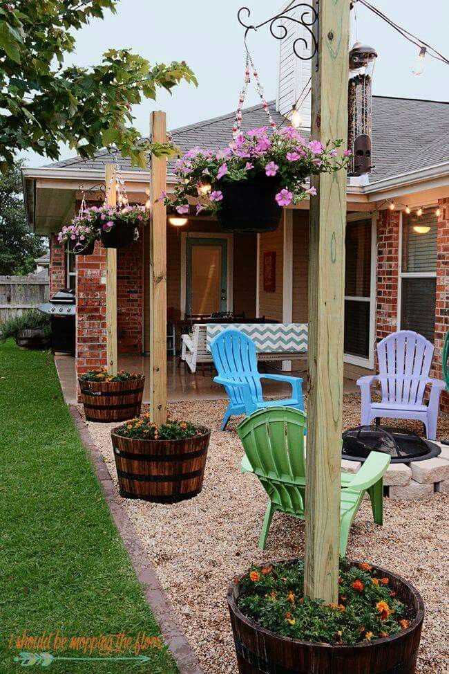 This gave me an idea-- we could use posts around our patio-- attach hanging hooks as shown-- but also drape string lights between!