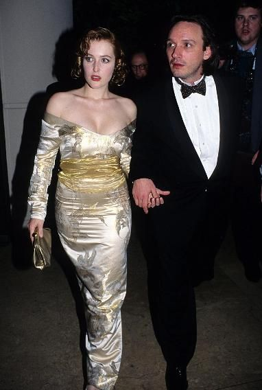 1995 Flashback: See Who Walked the Golden Globes Carpet 20 Years Ago | Gillian AndGillian Anderson     A stunning Gillian Anderson came to the Globes with her first husband Clyde Klotz, an art director on her show 'The X-Files.' Not yet a nominee, Anderson would go on to receive one Golden Globe award and three additional nominations for the Fox sci-fi series.