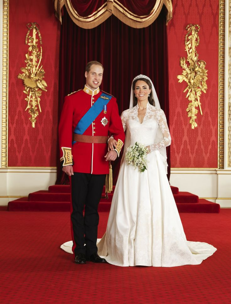 Prince William and his bride Catherine, Duchess of Cambridge, pose for an official photograph, in the throne room at Buckingham Palace.