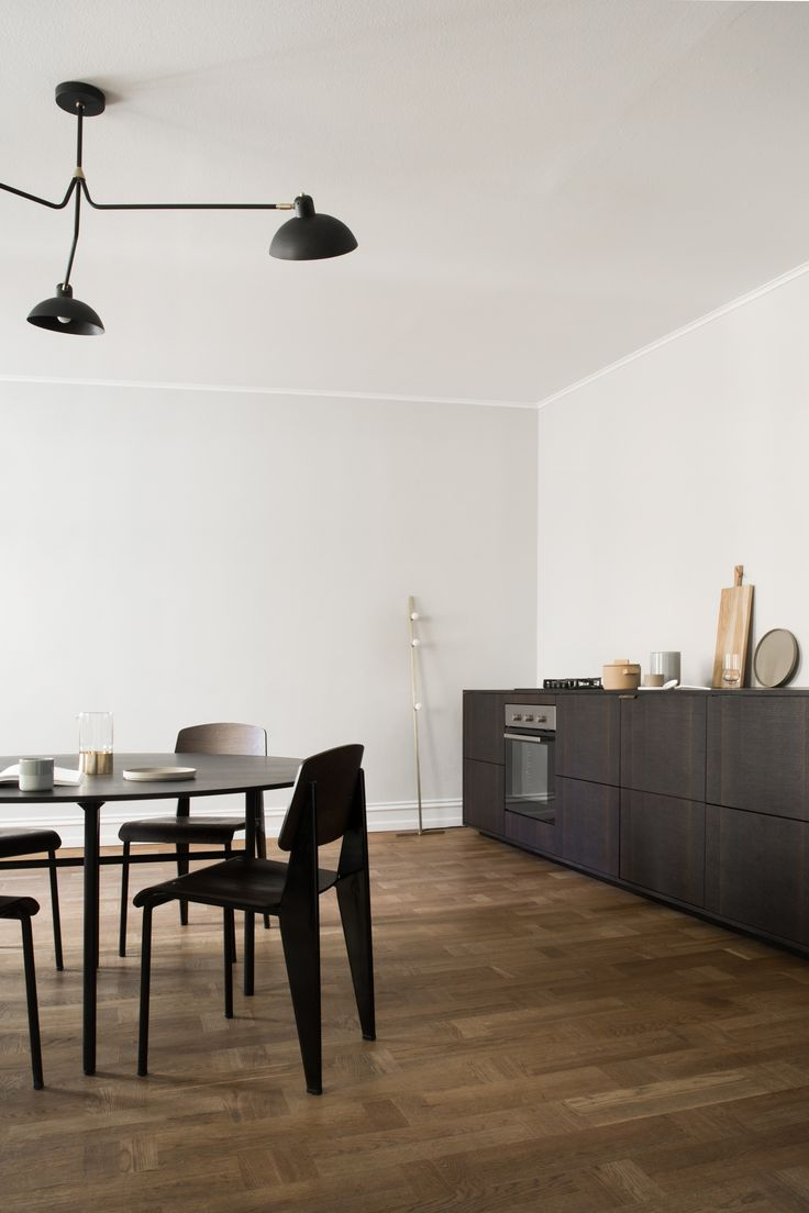 Reform's Norm Architects kitchen design in sawn smoked oak, bronzed tombac handles and table top in solid smoked oak.