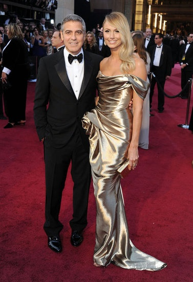 Oscars 2012. Stacy in Marchesa looked like George Clooney's Oscar Statue on his arm. I loved it.