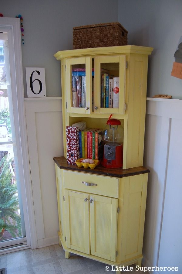 Laminate corner cabinet from big box store gets a makeover with paint. Perfect extra storage for kitchen.