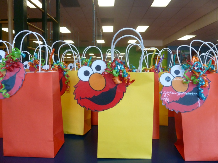 Goodie Bags with Elmo face cut out. The back (not pictured) says ...