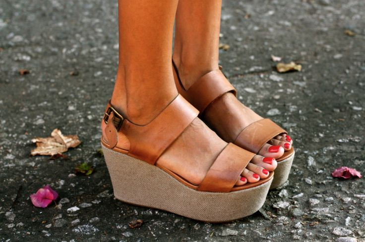 Want these shoes! High wedge, yet keeps your feet relatively flat so your foot doesn't fatigue like in heels.  I hate being short!!!!!!