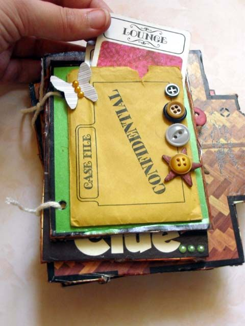 punk projects: Recycled Clue Game Mini Album DIY http://www.punkprojects.com/2011/07/recycled-clue-game-mini-album-diy.html