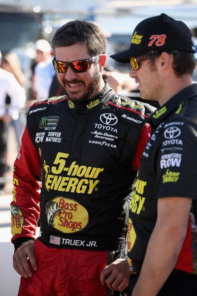 Martin Truex Jr., driver of the #78 5-hour Energy/Bass Pro Shops Toyota, stands on the grid during qualifying for the Monster Energy NASCAR Cup Series TicketGuardian 500 at ISM Raceway on March 9, 2018 in Avondale, Arizona.
