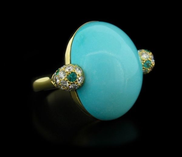 18.1o Carats of Stunning Turquoise Cabachon amongst 18K White Gold. Dressed with .47 Carats of Diamonds