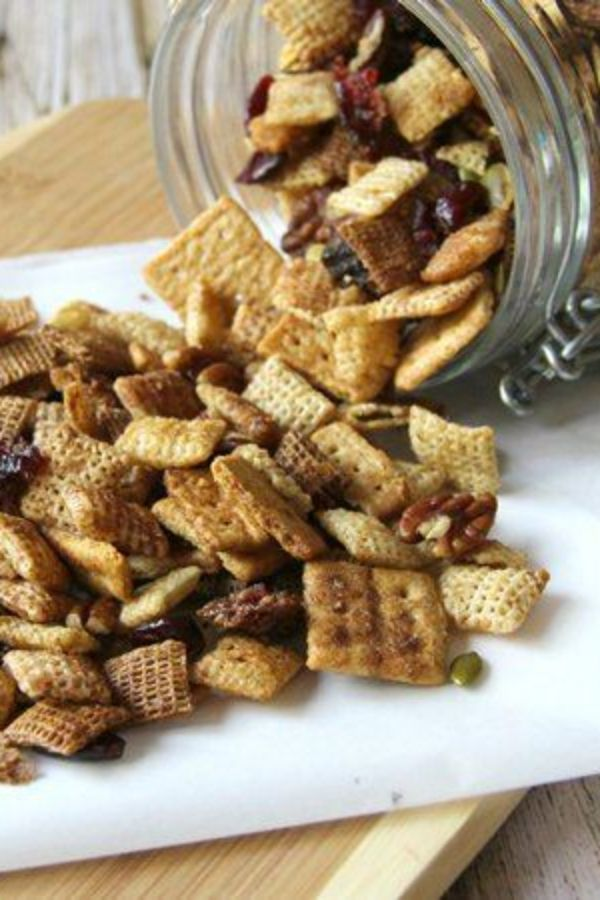 """Put your slow cooker on snack duty with this addictive pumpkin-spice Chex mix. Set some out for family and friends to nibble on while you cook—and to keep hovering guests out of the kitchen! Make an extra batch ahead of time and package up in cute fall-themed bags for guests to take home. Betty members suggest using a slow-cooker liner to make cleanup even easier. Looks for pumpkin seeds with the other nuts and seeds at the supermarket (they're also called """"pepitas"""")."""