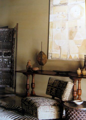 from the book, African Interior Design  NB : fauteuil contemporain recouvert de tissu africain.