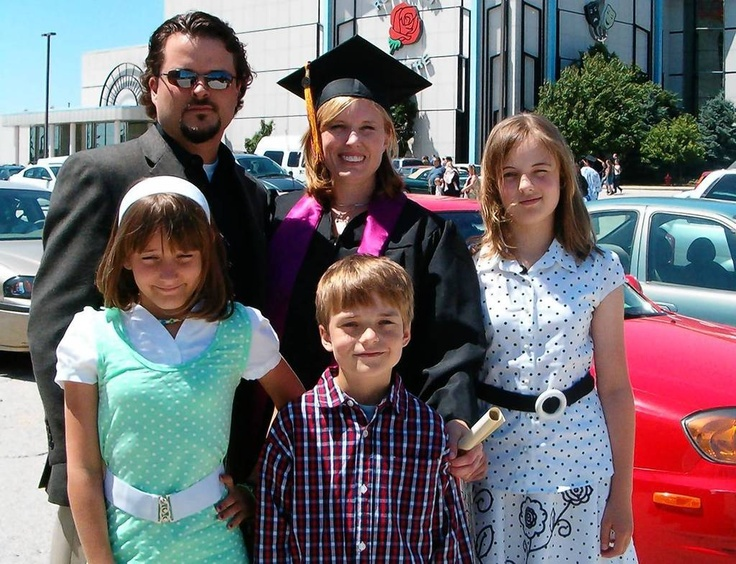 Christopher Vaughn poses with his wife Kimberly at her June 7, 2007, graduation from Phoenix University. With them are their children Cassandra (from left), Blake and Abigayle.