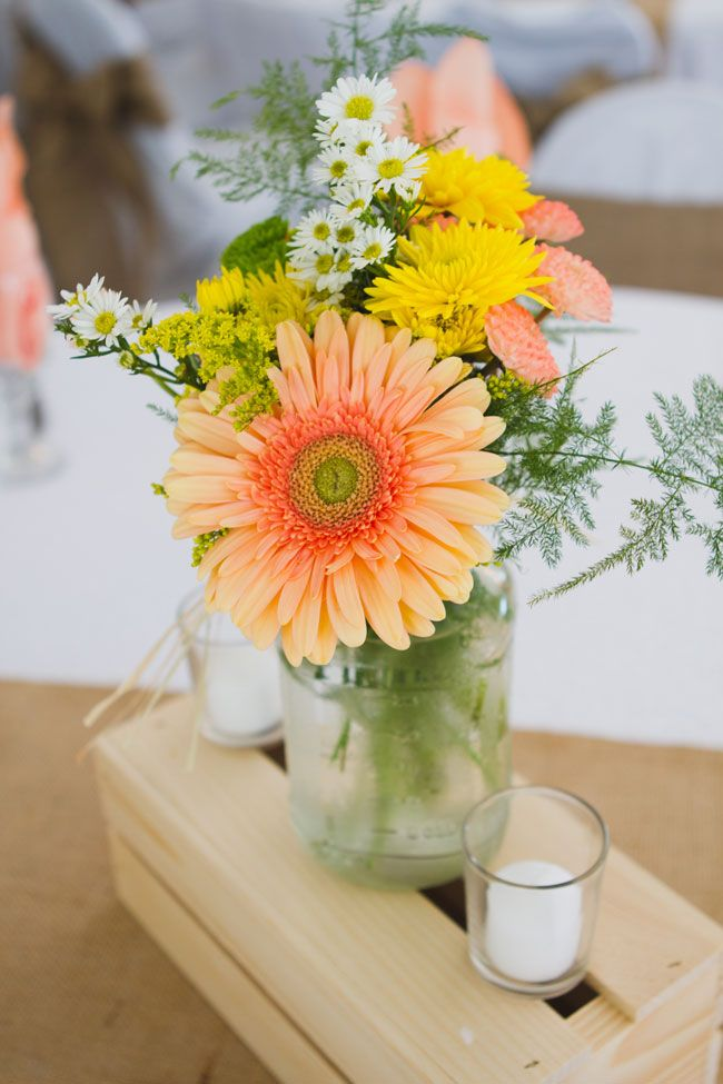 Soft Coral & Yellow Wildflower centerpieces in mason jars | Indie Rustic Garden Wedding At Florida's Saxon Manor  | Photograph by Horn Photography & Design  http://storyboardwedding.com/indie-rustic-garden-wedding-flordia-saxon-manor/