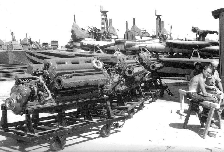 PT-208, a Higgins 78-foot motor torpedo boat in zebra paint, receiving three new Packard W-14 M2500 replacement engines at Bizerte, Tunisia, 1943. Note the raised rocket launcher rails on the bow.