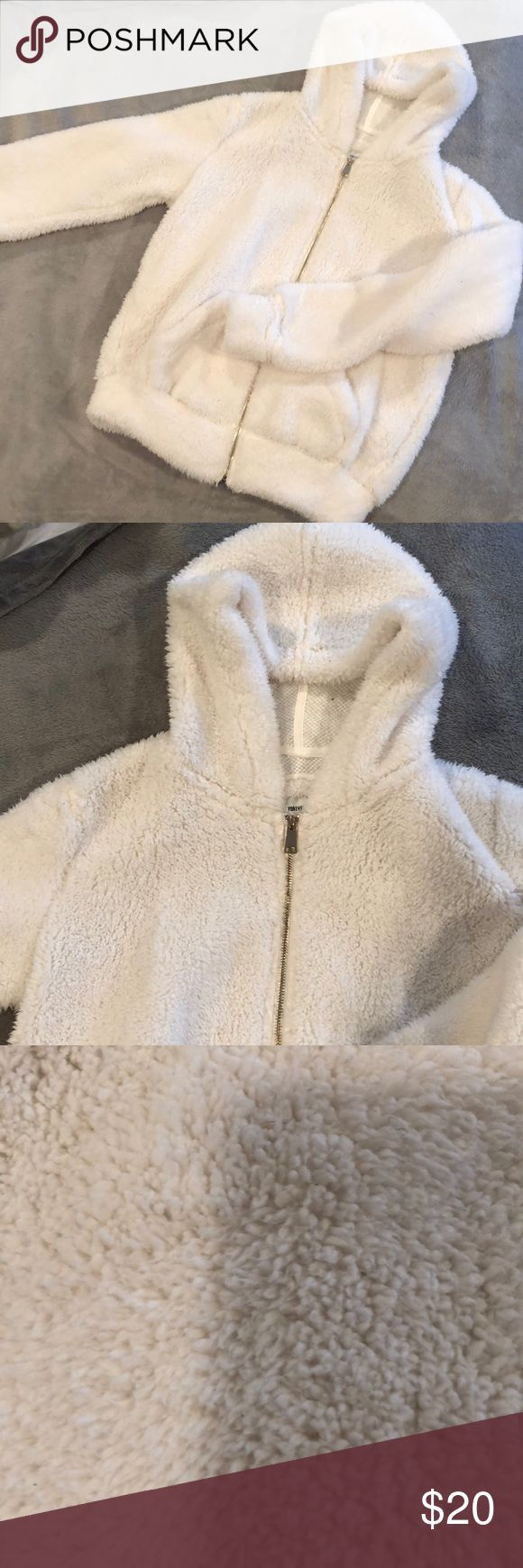 Fuzzy furry zip up hoodie Super cute fuzzy furry white zip up. Only washed and worn once. Forever 21 Tops Sweatshirts & Hoodies