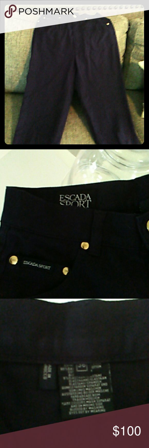 ESCADA Sport Jeans These navy blue ESCADA Sport jeans have only been worn twice. They are designed with five pockets and finished with a slightly tapered straight leg. Gold toned buttons embellish the front of these ultra comfy, yet stylish jeans. Stitching design grace the back pockets. Make them your new weekend favorite! ESCADA Sport Jeans Skinny
