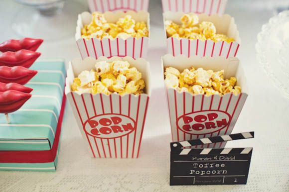 Popcorn confetti and refreshments for this cinema inspired wedding.  http://www.lovemydress.net/blog/2012/09/cinema-wedding-1950s-movies-tiffany-blue.html