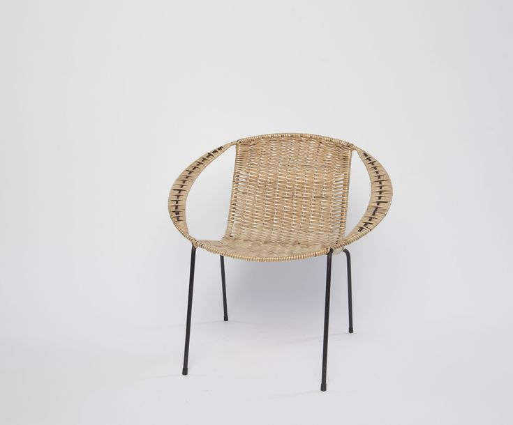 coolie chair, unknown maker, circa 1950-1970, New Zealand. Plasticised cane, steel. Collection of Auckland Museum 2006.111.1