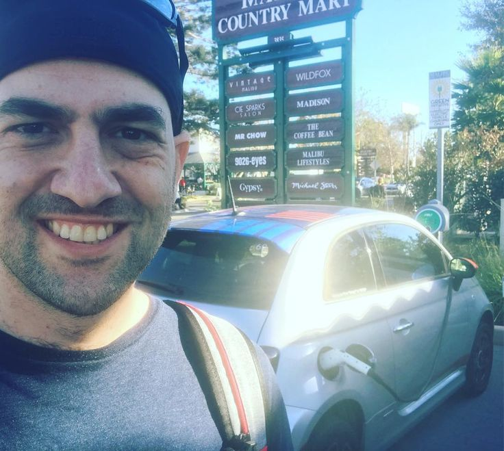 I wanted to see what its like taking an electric car by @envoythere to a road trip that is longer than what the battery can do. So I found me a free electric charging station in Malibu. Problem solved.  #people #man #outdoors #one #business #adult #travel #outdoor #portrait #vehicle #electriccar #electriccharging #fun #malibu #car #young #drag race #offense #511tactical #selfie #oakley #oakleysunglasses #architecture #fiat500e #greenEnergy #electricvehicle #lifestyle #california