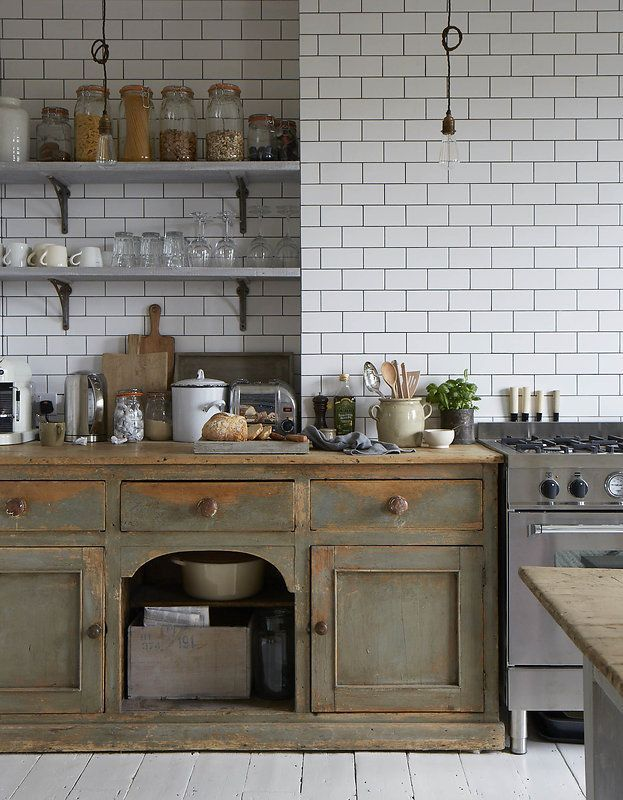 FARMHOUSE – INTERIOR – vintage early american farmhouse showcases raised panel walls, barn wood floor, exposed beamed ceiling, and a simple style for moulding and trim, like in this farmhouse kitchen featured in the new victorian ruralist.